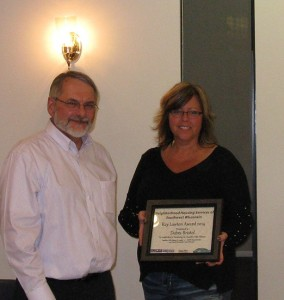 Barry Ziegahn, (L) NHSSW Board President awards Debra Bristol (R) the Ray Lawton Award